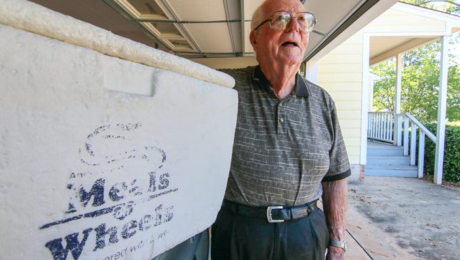 Clyde Hobbs of Anderson keeps a styrofoam cooler he used in the 30 years of delivering hot meals to residents in Anderson County for Meals on Wheels.