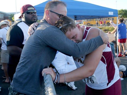 South Kitsap's Nolan Van Amen embraces his father,