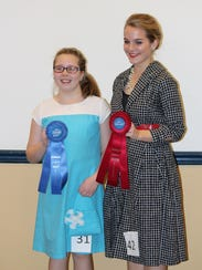 Rebekah Aldrich, left, and Kyra Rotz, right, members
