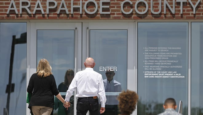 Lonnie and Sandy Phillips, left, whose daughter Jessica Ghawi was killed in the 2012 Aurora movie theater massacre, enter the Arapahoe County District Court on the day of closing arguments in the trial of Aurora movie theater shootings defendant James Holmes, in Centennial, Colo., July 14, 2015.