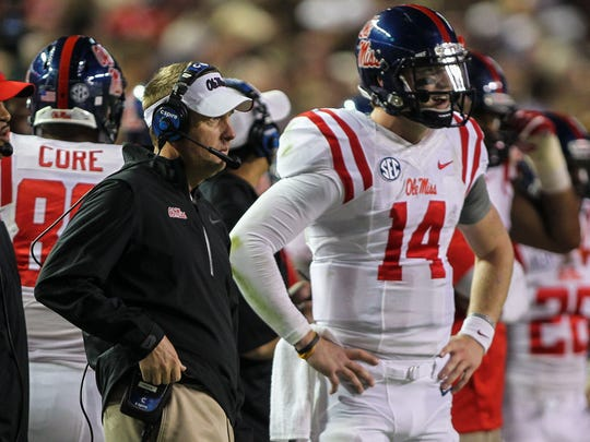 Bo Wallace and coach Hugh Freeze have Mississippi unbeaten