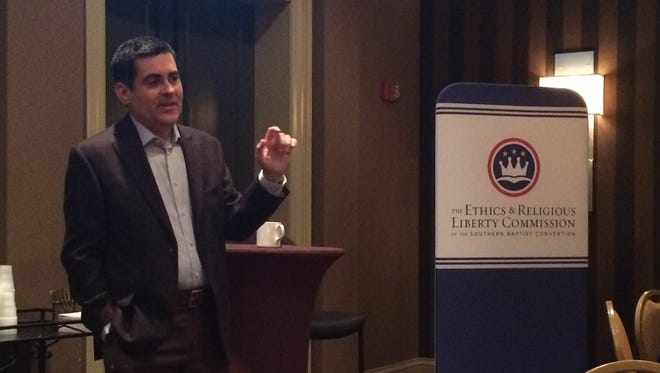 Russell Moore, the president of the Southern Baptist Convention's Ethics and Religious Liberty Commission, answers questions about religious liberty and politics during a media event at the ERLC National Conference. The public policy arm's conference is being held at Gaylord Opryland Resort & Convention Center in Nashville.