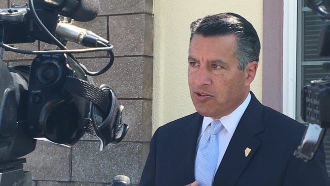 Gov. Brian Sandoval speaks Tuesday about health care options for rural Nevadans.