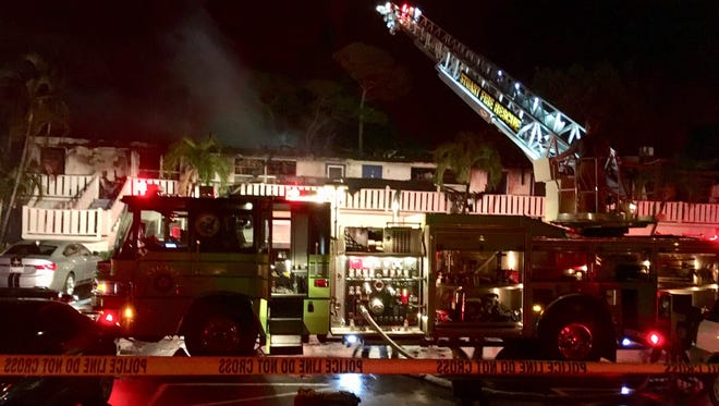 A Martin County Fire Rescue truck stands by at the scene of a residential fire Monday night, May 28, 2018, at Cedar Pointe Villages off Southeast Ocean Boulevard, Stuart.