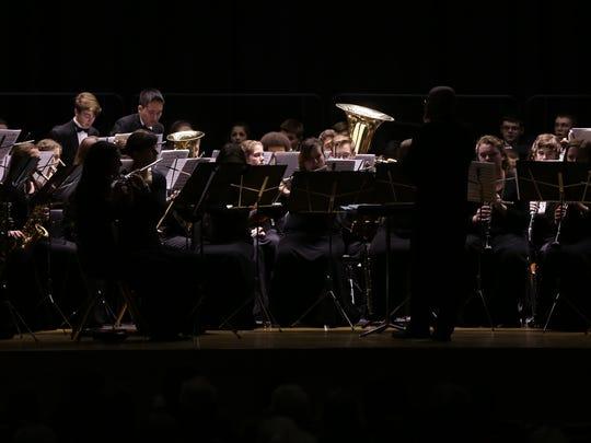 Members of Carmel High School's Chorus and Wind Ensemble