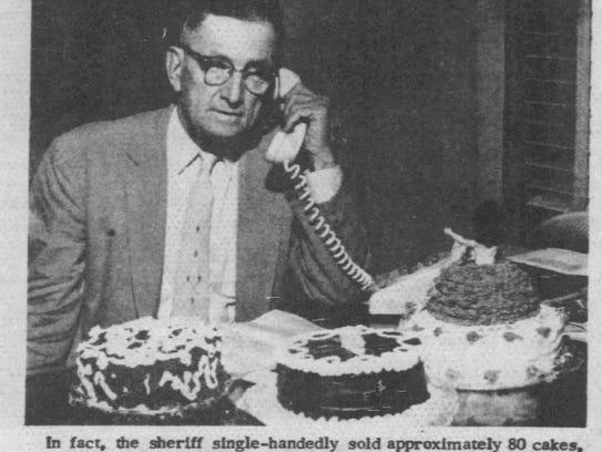 """St. Landry Parish Sheriff D.J. """"Cat"""" Doucet sells cakes"""