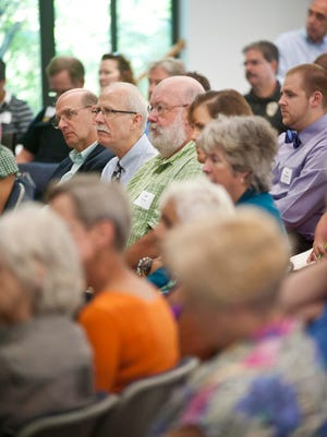 Community members listen to a presentation during a public forum on opiate addiction hosted by the United Way of Chittenden County at the Vermont Commons School in South Burlington on Tuesday.