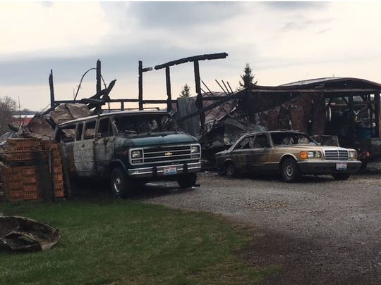 An early Thursday morning fire at 5923 Crestline Road destroyed a barn owned by Hal and Randa Wagner. Also lost were vehicles, a machine shop and a litter of kittens.