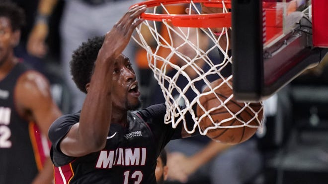Miami Heat's Bam Adebayo slams home a dunk during the first half of an NBA conference final playoff basketball game against the Boston Celtics Sunday in Lake Buena Vista, Fla.
