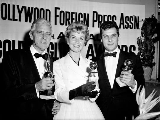 Actress Doris Day, center, Tony Curtis, right, and