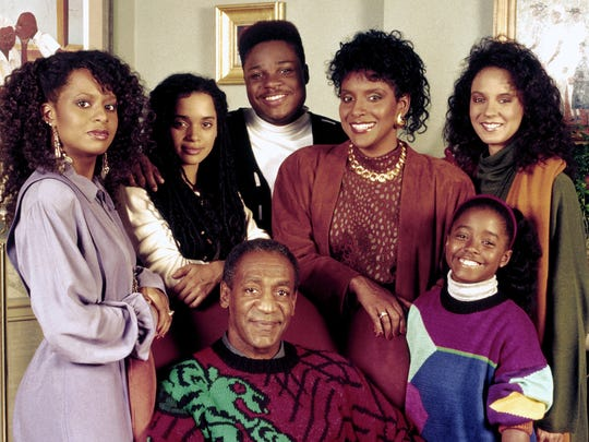 "Bill Cosby (center) as Dr. Cliff Huxtable, the beloved patriarch of ""The Cosby Show,"" with his co-stars (from left) Tempestt Bledsoe (as Vanessa), Lisa Bonet (Denise), Malcolm-Jamal Warner (Theo), Phylicia Rashad as (Clair), Keshia Knight Pulliam (Rudy) and Sabrina Le Beauf (Sondra)."