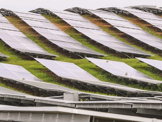 Rows of photo voltaic panels mounted on static steel frames on the rolling hills at nrg Renew's Dandan Solar Facility are shown in this Aug. 14 file photo.