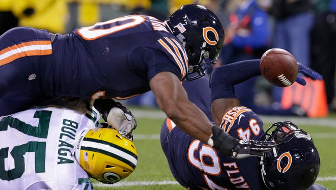 Chicago Bears outside linebacker Leonard Floyd (94) recovers a fumble by Green Bay Packers quarterback Aaron Rodgers (not pictured) in the end zone for a touchdown.