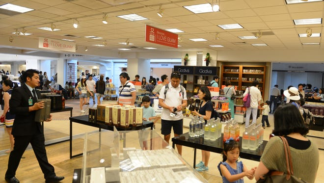 In this file photo, customers check out goods at Lotte Duty Free's store at A.B. Won Pat Guam International Airport on July 25, 2016.