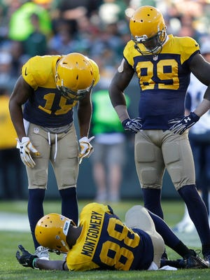 Green Bay Packers wide receiver Randall Cobb and James Jones check on wide receiver Ty Montgomery after he was injured on a pass play in the second quarter.The Green Bay Packers host the San Diego Chargers, Sunday, October 18, 2015 at Lambeau Field in Green Bay, Wis.