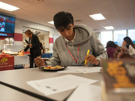Student Savan Patel grades one of Sodexo's menu tweaks at Vineland High School.