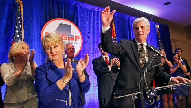 Republican Gov. Phil Bryant, right, and wife Deborah acknowledge friends and supporters  Tuesday in Jackson. Bryant easily won a second term as Mississippi governor Tuesday, defeating a truck driver who ran a low-budget campaign as the Democratic nominee.