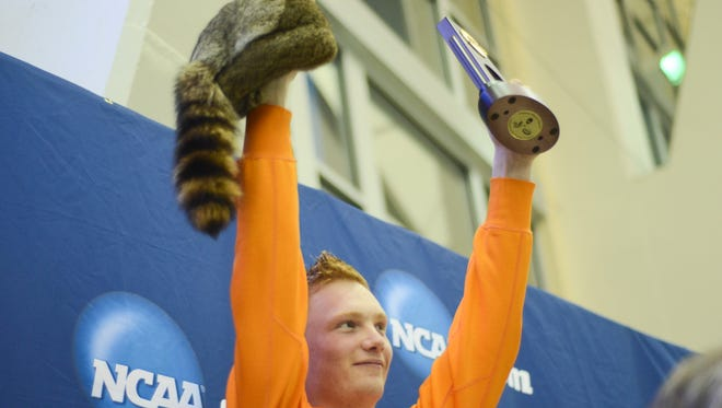 Liam Stone poses with his trophy after winning the NCAA 1-meter springboard title in 2016.