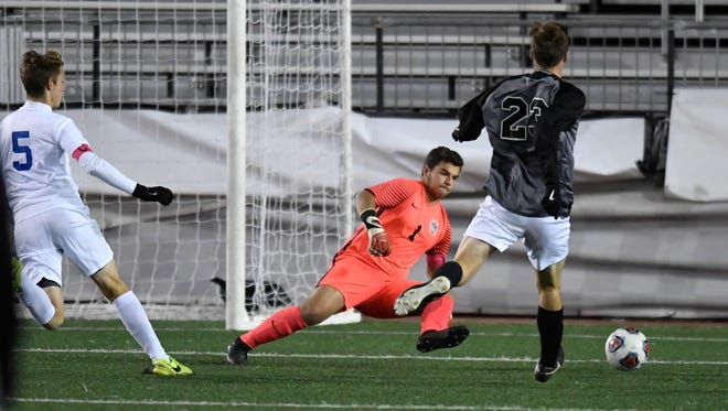 Castle's Michael Bertram looks to protect the goal last year in the Class 3A state championship loss to West Lafayette Harrison at Michael A. Carroll Stadium in Indianapolis. Bertram has committed to Wabash College.