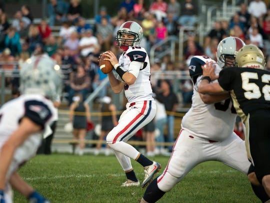 New Oxford's Brayden Long looks to pass in the first quarter, Friday, September 15, 2017. The Squires defeated the Colonials, 44-19.