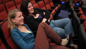 Bethany Wolstenholme (left) and Deborah Holcombe watch a Philadelphia Eagles game at Theatre N in 2011.