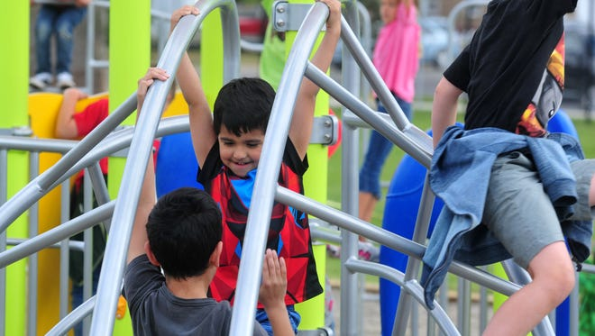Giant Springs Elementary students enjoy the playground at the school.