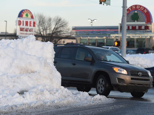 Drivers making a right turn from Route 30 in the westbound lane onto Kenneth Road in West Manchester township on Monday found their view obstructed by the large pile of snow left over from this weekend's snowstorm.