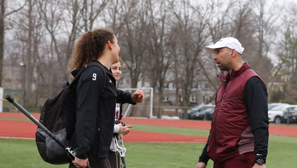 Scarsdale's Athletic Director Ray Pappalardi talks girls lacrosse players after their 8-10 loss to Mahopac at Scarsdale High School on March 29, 2018.