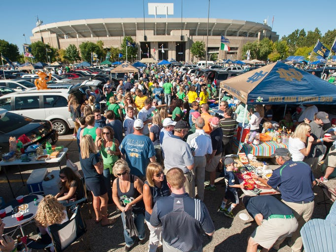 Tailgaters enjoy the nice weather outside of Notre Dame Stadium before the game.