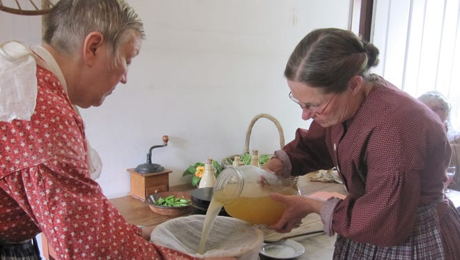 Actors demonstrate how to brew ginger beer at the Wade House in Greenbush.