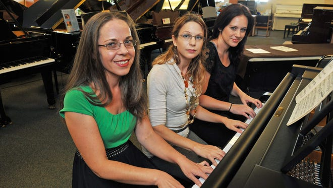 Atlantic Music Center in Melbourne will host the 2015 American Jazz Pianist Competition, which will be held at the Gleason Auditorium at the Florida Institute of Technology, Nov. 13-15. Karolyn McDonald, office manager, Jamie Younkin, vice president for the upcoming competition, and April Florio, marketing chair with Atlantic Music Center pose for a promo for the competition.