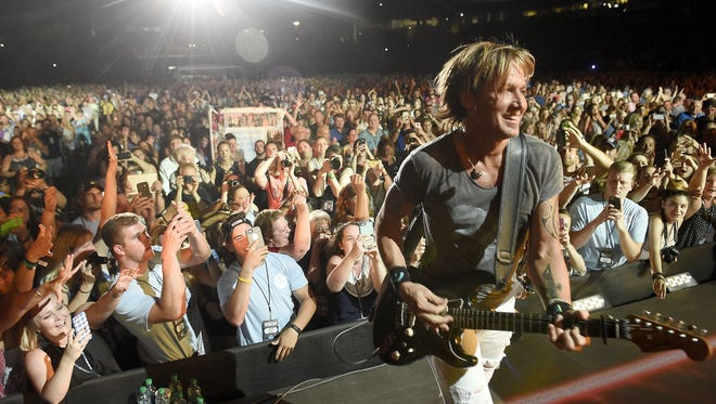 Keith Urban performs during the 2016 CMA Music Festival at Nissan Stadium in Nashville.
