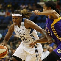 Minnesota Lynx forward Rebekkah Brunson (32) drives the ball around Los Angeles Sparks center Candace Parker (3) during the first half Wednesday in Minneapolis.