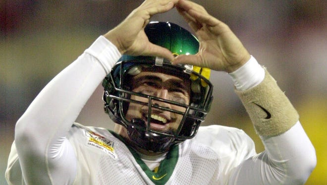 Oregon quarterback Joey Harrington makes his school hand sign to celebrate a fourth quarter touchdown against Colorado Tuesday, Jan. 1, 2002 at the Fiesta Bowl at Sun Devil Stadium in Tempe, Ariz. Oregon beat Colorado 38-16.
