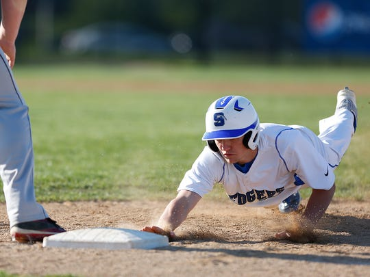 St Mary's Springs High School's Blake Ottery dives back to first base to avoid being picked off against Lomira on Tuesday afternoon, May 17, 2016, in Fond du Lac. Springs went on to win the game 11-1 in five innings.