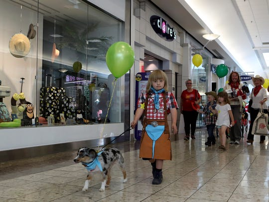 Colby Maxwell, 6, walks his dog Texas during the Asphalt Cowboys' annual kiddie pet parade at the Mt. Shasta  Mall on Thursday for Redding Rodeo Week.