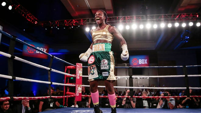 Claressa Shields celebrates defeating Nikki Adler after five rounds at the WBC and IBF super middleweight title fight at MGM Grand Detroit, Aug. 4, 2017 in Detroit.