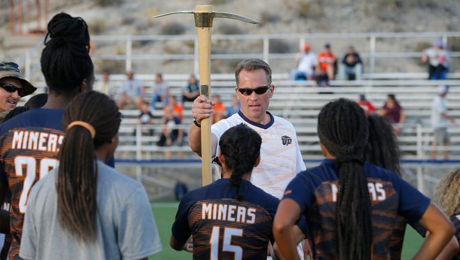 UEP soccer coach Kevin Cross hands off the Miner Pick to UTEP junior forward Danielle Carreon before the start of the teams match against Lubbock Christian Friday night at University Field. The Miners would pick up their first win of the season 6-1 over Lubbock Christian.