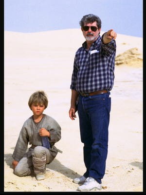 George Lucas talks with Jake Lloyd who plays Anakin Skywalker on the set of the film Star Wars: Episode I The Phantom Menace, which was filmed partially in Tunisia in 1999. The country has become a growing tourist destination after democratic reforms in 2011.