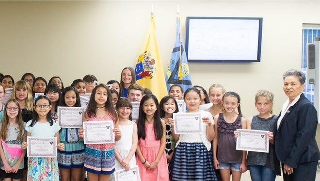 Middlesex County Sheriff Mildred S. Scott presented awards to sixty four grade school student artists.