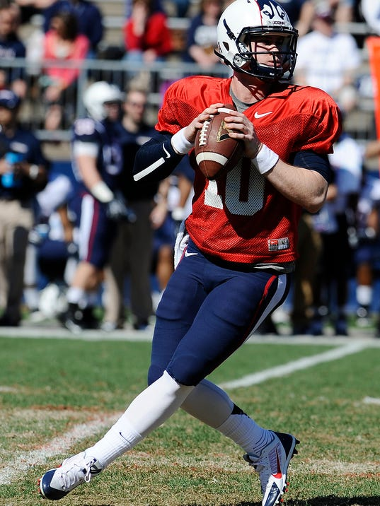 Connecticut quarterback Chandler Whitmer looks down field for a receiver during the first half of UConn's Blue-White spring NCAA college football game at Rentschler Field, Saturday, April 12, 2014, in East Hartford, Conn. (AP Photo/Jessica Hill)