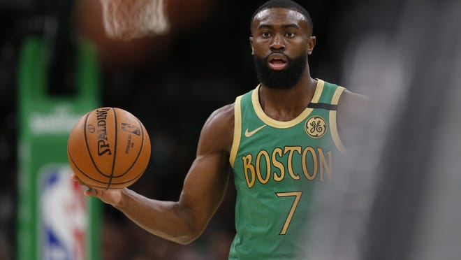 """Every arena needs to be open,' the Celtics' Jaylen Brown said, stressing the need for more access to voting for minority communities."