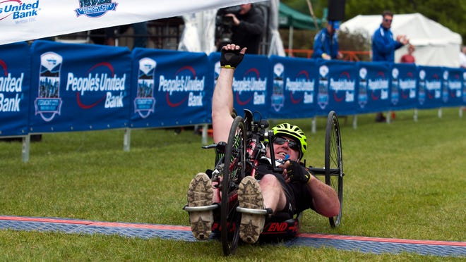 Handcyclist Larry Nadeau of Springfield crosses the finish line in first place during the People's United Bank Vermont City Marathon & Relay on Sunday morning. Nadeau was third a year ago.