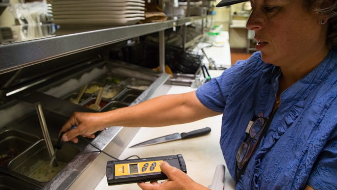 Riverside County health inspector Becky Baccari checks food temperatures at a restaurant in Rancho Mirage on Tuesday, Aug. 5, 2014.