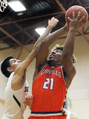 Nathan Eggleton, 21, of Canutillo rises up for a shot against Abraham Serrano of Del Valle Tuesday night.