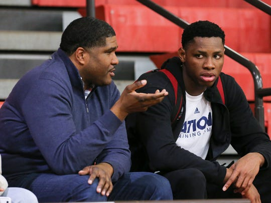 Former U of L assistant coach Kenny Johnson, left, chatted with Aspire Academy's Charles Bassey (23) after Aspire's game against Orangeville Prep at Seneca High School.   Feb. 9, 2018