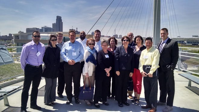 Pictured from left to right: Kaveh Mostafavi, Nancy Quellhorst, Kelly Hayworth, Steve Long, Chad Simmons, Susan Mims, Gabe Erickson, Wendy Ford, Ellen Habel, Rebecca Neades, Jeff Fruin, Kate Moreland, Todd Means and RJ Jerrick.