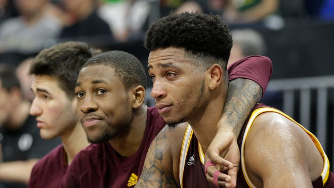 Iona's Rickey McGill center, and Jordan Washington, right, watch the closing moments of their 93-77 loss to Oregon of a first-round game in the men's NCAA college basketball tournament Sacramento, Calif., Friday, March 17, 2017.
