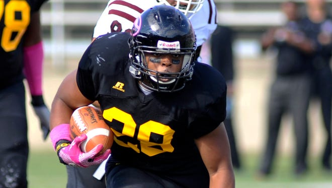 Grambling running back Jestin Kelly (28) searches for running room against Texas Southern in the first half Saturday in Grambling, La.