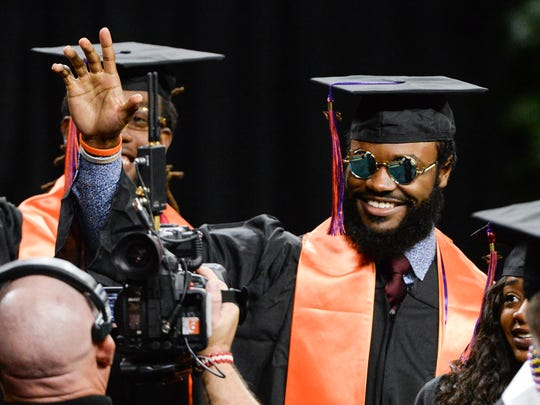 Clemson wide receiver Trevion Thompson waves during Clemson graduation in Littlejohn Coliseum on Thursday morning.